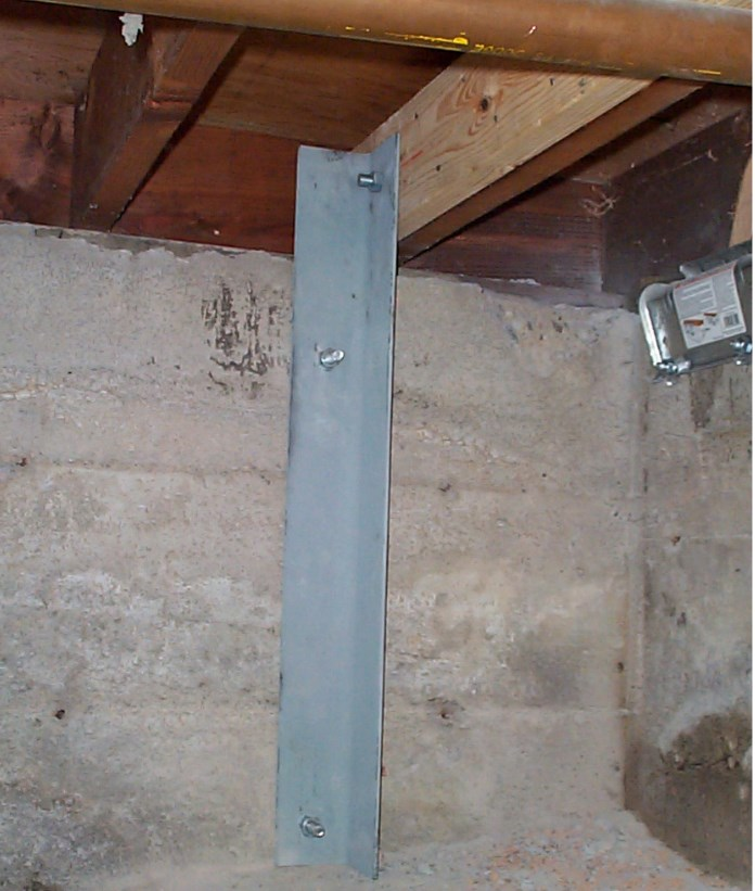 Photograph of angle iron installed under house