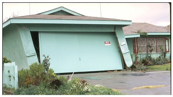 Overturning of garage similar to overturn of shear walls.