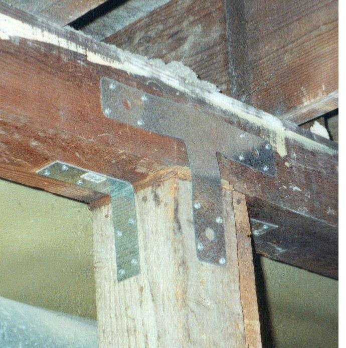 Photograph of metal T-strap attaching post to girder (beam) also found in plans created by seismic retrofit engineer