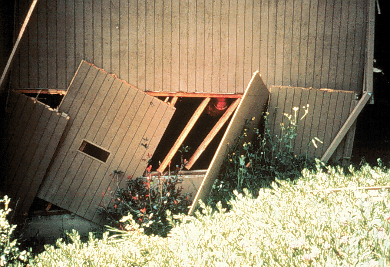 Collapsed cripple wall at the base of a leaning house