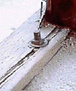 SPLIT MUDSILL CAUSED BY FOUNDATION BOLT