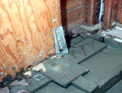 Concrete under shear wall hold down