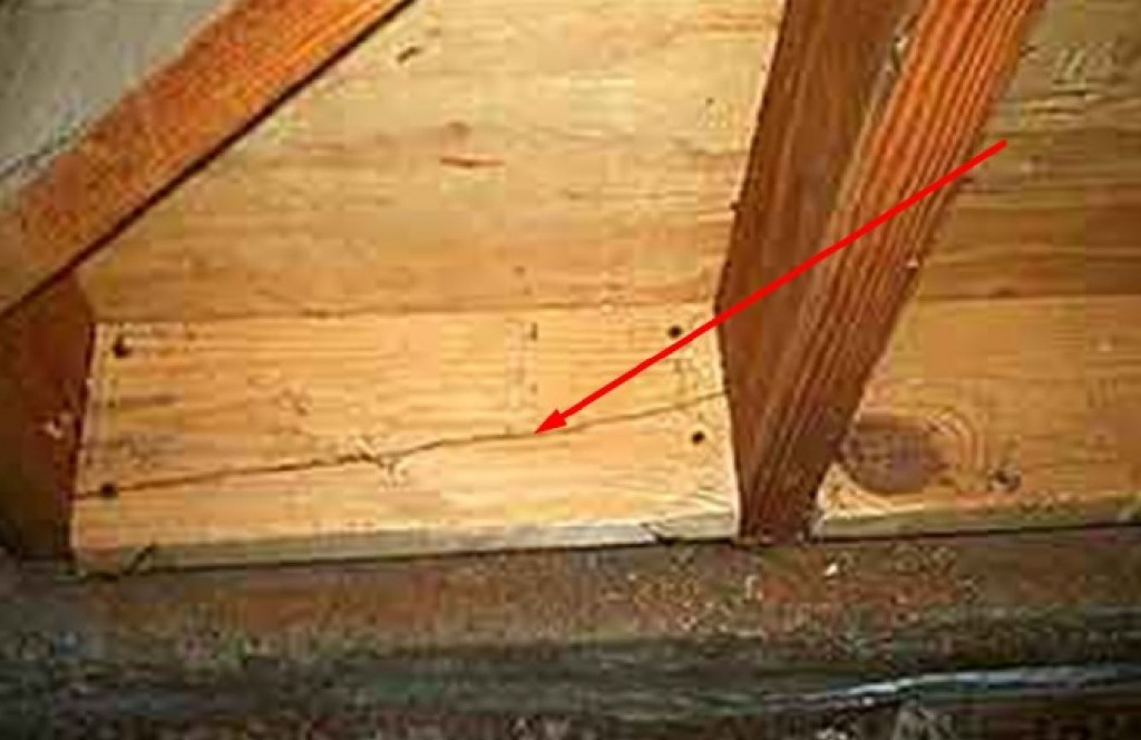 This photo shows how nails can split the sill blocking