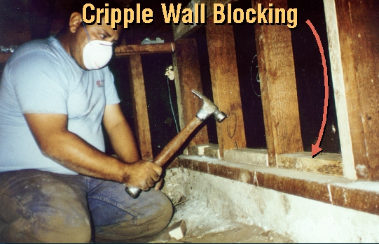 BLOCKS BEING NAILED TO CRIPPLE WALL MUDSILL