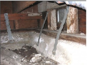 Ineffective steel straps attaching floor to foundation because no retrofit building codes