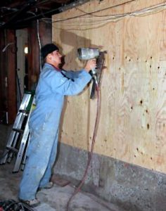 CARPENTER NAILING PLYWOOD