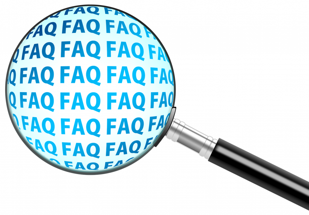 "A magnifying glass with the text ""FAQ"" showing under its lense"